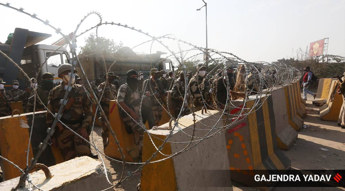 At Delhi borders, police wall manages to slow down marching farmers